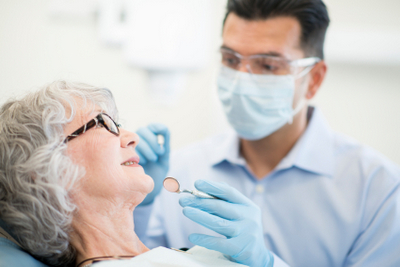Doctor examining patient at Oral Surgery Specialists of Austin